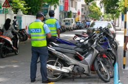 Traffic Police placing stickers on motor vehicles parked outside a parking zone. Under the amendment to the Land Transport Act, authorities can impose community service on individuals who are unable to pay their parking and traffic fines. PHOTO: MIHAARU