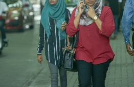 Maldivians captured whilst on their way to work, pre-social distancing prompted by the spread of novel Coronavirus this year. PHOTO: MIHAARU
