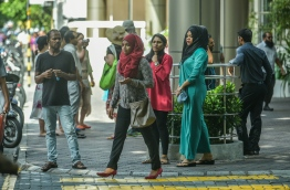 File photo of civil service workers in front of Velaanaage in the capital city, Male'. PHOTO: NISHAN ALI/MIHAARU