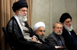 A handout picture provided by the office of Iran's supreme leader Ayatollah Ali Khamenei on June 14, 2016 shows him and (LtoR) Iranian President Hasan Rouhani, Iran's Parliament speaker, Ali Larijani, and former judiciary chief Mahmoud Hashemi Shahroudi attending a meeting with Iranian senior officials in Tehran. The Iranian supreme leader has warned candidates in the US presidential election against questioning the Islamic republic's nuclear deal with world powers. / AFP PHOTO / KHAMENEI.IR / HO /