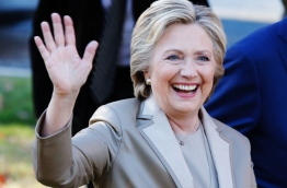 "Democratic presidential nominee Hillary Clinton greets supporters after casting her vote in Chappaqua, New York on November 08, 2016. Chanting ""Madam President,"" about 150 supporters turned out to cheer on the Democratic nominee who voted with husband Bill Clinton at an elementary school near their home in Chappaqua / AFP PHOTO / EDUARDO MUNOZ ALVAREZ"