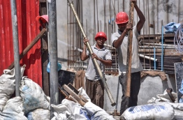 Expatriate employees working on a construction cite, the government has increased quota fees to MVR 2000. PHOTO: NISHAN ALI