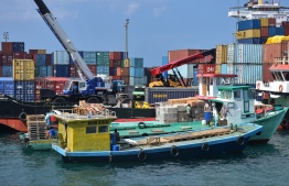Cargo unloading at the commercial harbour in Male'. PHOTO: NISHAN ALI / MIHAARU