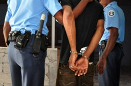 Police arrest a man, and take him away in handcuffs. FILE PHOTO/MIHAARU