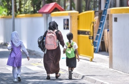 A parent walking their children to school. Ministry of Education announced that schools will reopen on July 1 after a long shutdown period due to COVID-19. PHOTO: HUSSAIN WAHEED/ MIHAARU