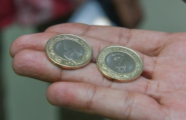 A file photo of two Rufiyaa coins. PHOTO: HUSSAIN WAHEED/MIHAARU