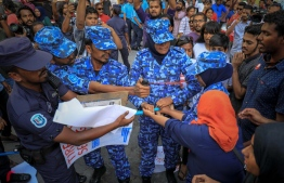 A peaceful protest is broken up the Maldives Police Services' Special Operations unit on August 8, 2017. An officer is pictured pepper-spraying protestors. PHOTO: MIHAARU FILES