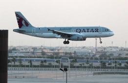 An aircraft of Qatar Airways landing. PHOTO: AFP