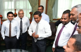 Former Minister of Islamic Affairs Dr Ahmed Ziyad Bagir (C-R) alongside former President Abdulla Yameen Abdul Gayoom (C) and other cabinet ministers of the past administration. PHOTO: MIHAARU FILES