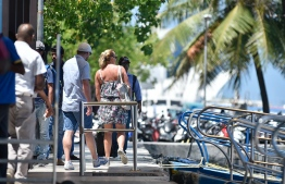 Tourists headed towards the airport ferry in capital Male'. PHOTO: HUSSAIN ALI/ MIHAARU