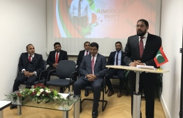 Qasim Ibrahim (R) speaks at a meeting in Frankfurt, Germany, after ex-VP Dr. Mohamed Jameel and several others signed onto Jumhooree Party.