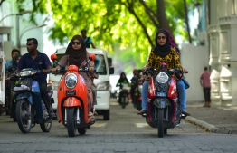 Female civil servants driving to work in the capital city of Male'. PHOTO: HUSSAIN WAHEED/ MIHAARU