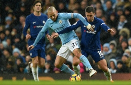 Manchester City's Spanish midfielder David Silva (L) vies with Chelsea's Belgian midfielder Eden Hazard during the English Premier League football match between Manchester City and Chelsea at the Etihad Stadium in Manchester, north west England on March 4, 2018. / AFP PHOTO / Oli SCARFF / RESTRICTED TO EDITORIAL USE. No use with unauthorized audio, video, data, fixture lists, club/league logos or 'live' services. Online in-match use limited to 75 images, no video emulation. No use in betting, games or single club/league/player publications.  /
