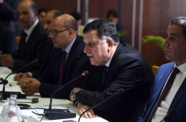 "Libyan Prime Minister Fayez al-Sarraj (2nd R) said the presence of foreign ground troops to fight the Islamic State group would be ""contrary to our principles"" (AFP Photo/Fethi Belaid)"