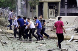 Three people were killed and dozens injured in a car bombing on June 8, 2016 at a police station in southeast Turkey, a day before 11 people were killed in an attack on police in Istanbul. / AFP PHOTO