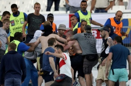 Groups of supporters clash fight at the end of the Euro 2016 group B football match between England and Russia at the Stade Velodrome in Marseille on June 11, 2016. / AFP PHOTO