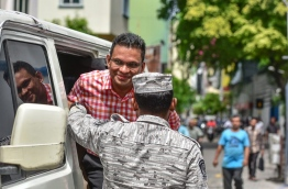 Former defence minister Nazim smiles as he enters the Supreme Court for the second pre-trial hearing on Tuesday. MIHAARU PHOTO/NISHAN ALI