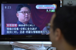 A man looks at a television reporting on North Korea's missile launching in Tokyo on June 22, 2016. North Korea test fired what appeared to be two medium-range Musudan missiles in quick succession on June 22, South Korea's Yonhap news agency said. / AFP PHOTO / KAZUHIRO NOGI