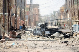 Destruction is seen in Fallujah, 50 kilometres (30 miles) from the Iraqi capital Baghdad, after Iraqi forces retook the embattled city from the Islamic State group on June 26, 2016. Iraqi Prime Minister Haider al-Abadi urged all Iraqis to celebrate the recapture of Fallujah by the security forces and vowed the national flag would be raised in Mosul soon. While the battle has been won, Iraq still faces a major humanitarian crisis in its aftermath, with tens of thousands of people who fled the fighting desperately in need of assistance in the searing summer heat./ AFP PHOTO / HAIDAR MOHAMMED ALI