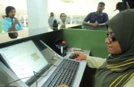 An immigration officer pictured at the Ibrahim Nasir International Airport (INIA). PHOTO/IMMIGRATION