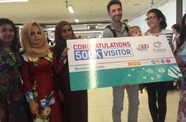 MMPRC officials greet the 500,000th visitor to Maldives this year. MMPRC FILE PHOTO