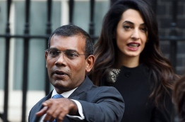 Former President of Maldives Mohamed Nasheed (L) and British lawyer Amal Clooney (R) leave after a meeting with British Prime Minister David Cameron (not pictured) at 10 Downing Street in London, Britain, 23 January 2016. The former president of the Maldives has been granted temporary release from prison to fly to Britain for surgery. EPA/ANDY RAIN