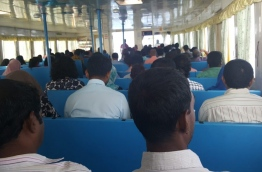 People pictured in a ferry operated by MTCC.
