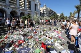 The Islamic State group claimed responsibility for the truck attack that killed 84 people in Nice on France's national holiday, a news service affiliated with the jihadists said on July 16. Tunisian Mohamed Lahouaiej-Bouhlel, 31, smashed a 19-tonne truck into a packed crowd of people in the Riviera city celebrating Bastille Day -- France's national day. / AFP PHOTO / Valery HACHE