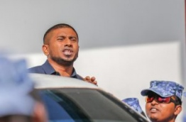 MP Mahloof reacts as he is led away by police after the criminal court sentenced him to four months in jail on Monday. MIHAARU PHOTO/MOHAMED SHARUHAAN