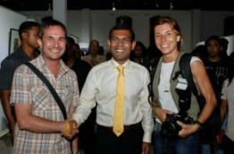 The two journalists pictured with former president Nasheed in 2012.