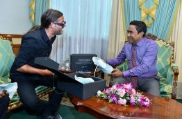 Parley presents pair of handmade shoes, made from plastic waste collected in the Maldives, to President Yameen on Wednesday. PHOTO/PRESIDENT'S OFFICE