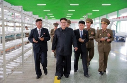 This undated picture released from North Korea's official Korean Central News Agency (KCNA) on July 30, 2016 shows North Korean leader Kim Jong-Un (2nd L) inspecting a newly-built combined fishing-tackle factory under the Korean People's Army (KPA) in Pyongyang. / AFP PHOTO / KCNA VIA KNS / KCNA