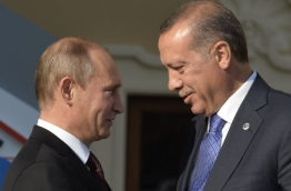 Ankara's downing of a Russian war plane over the Syrian border last November 2015 prompted rapid retaliation from Moscow and a bitter war of words between presidents Vladimir Putin and Recep Tayyip Erdogan from which there appeared no going back. But just half a year on Russia has accepted Ankara's expressions of regret over the incident and Erdogan will meet Putin in Saint Petersburg on August 8, 2016 for their first summit since the crisis erupted, in the hope of reviving the relationship. / AFP PHOTO / ERIC FEFERBERG