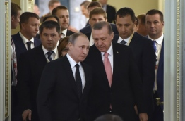 Putin said on August 9 that restoring trade ties with Turkey will take time and work, after his first meeting with counterpart Recep Tayyip Erdogan since Ankara shot down a Russian warplane last November. / AFP PHOTO / ALEXANDER NEMENOV