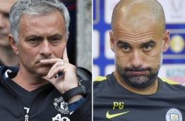 With Pep Guardiola at Manchester City and Jose Mourinho at Manchester United, Manchester threatens to become the centre of the footballing universe during the new Premier League season. / AFP PHOTO / JON SUPER AND WANG Zhao /