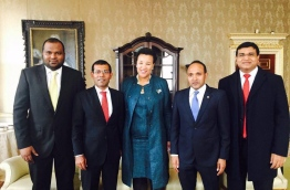 Ali Waheed (L), Nasheed (2nd L), Jameel (2nd R) and Ameen (R) pose for a picture with Commonwealth Secretary-General Patricia Scotland in UK.