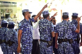 Police officers block a protest by journalists near the parliament building on August 1, 2016. MIHAARU PHOTO/HUSSAIN SHAYAAH