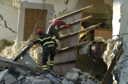 Italy held a tear-drenched funeral on August 27, 2016 for dozens of its earthquake victims as the country observed a day of mourning over a disaster that killed nearly 300 people. Emergency services are confident they have accounted for everyone in the smaller outlying hamlets to the north of Amatrice -- some of which have been so badly damaged there are doubts as to whether they will ever be inhabited again. / AFP PHOTO / ANDREAS SOLARO
