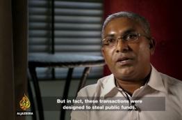 "A screen grab of the Al Jazeera documentary ""Stealing Paradise' shows former Auditor General Niyaz Ibrahim."