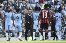 Manchester City's Spanish manager Pep Guardiola (C) talks with referee Jon Moss after Manchester City's Spanish midfielder Nolito (2L) was sent off during the English Premier League football match between Manchester City and Bournemouth at the Etihad Stadium in Manchester, north west England, on September 17, 2016. / AFP PHOTO / OLI SCARFF