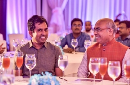 Economic minister Mohamed Saeed (L) speaks with the Indian Ambassador to the Maldives during the inauguration ceremony of Maldives Investment Forum 2016. PHOTO: NISHAN ALI/MIHAARU