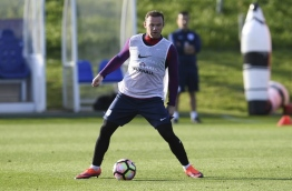 England's striker Wayne Rooney takes part in a training session at England's training facility at St George's Park in Burton-upon-Trent, in central England on October 4, 2016, ahead of England's 2018 World Cup qualifying football match against Malta on October 8. / AFP PHOTO / PAUL ELLIS / NOT FOR MARKETING OR ADVERTISING USE / RESTRICTED TO EDITORIAL USE