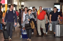 Tourists pictured at the Arrivals Hall in Ibrahim Nasir International Airport (INIA). PHOTO: NISHAN ALI/MIHAARU