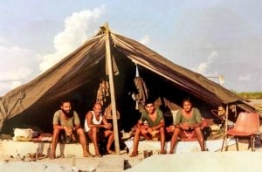 Soldiers of the Indian military, that arrived in the Maldives to stop the coup on November 3, 1988, sit in one of the tents erected in Hulhule airport for their stay.