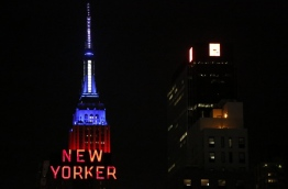 The Empire State building is lit up in the colors of the US national flag in New York on November 8, 2016. / AFP PHOTO / Kena Betancur
