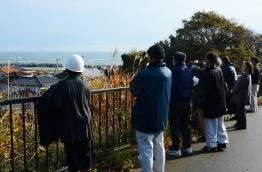 A powerful 6.9-magnitude earthquake hit northeastern Japan on November 22, triggering tsunamis along the coast including a one-metre (3.3-foot) wave that crashed ashore at the stricken Fukushima nuclear power plant. / AFP PHOTO / JIJI PRESS / JIJI PRESS / Japan OUT