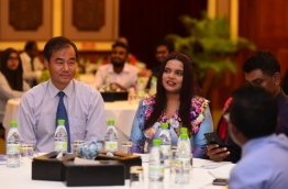 """Minister of Youth and Sports Iruthisham Adam (R) and Ambassador of China to the Maldives Wang Fukang at the convention held in Bandos Island Resort to give information on China's new Silk Road project, """"Belt and Road"""". PHOTO/YOUTH MINISTRY"""