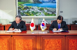 "Japan and South Korea signed a controversial agreement on November 23 to share defence intelligence on North Korea, despite protests from opposition parties and activists in Seoul. / AFP PHOTO / South Korea's Defence Ministry / HO / RESTRICTED TO EDITORIAL USE - MANDATORY CREDIT ""AFP PHOTO / SOUTH KOREA'S DEFENCE MINISTRY"" - NO MARKETING - NO ADVERTISING CAMPAIGNS - DISTRIBUTED AS A SERVICE TO CLIENTS"