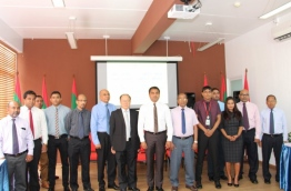 Environment Minister Thoriq Ibrahim (C) poses for picture with the heads of airport operating companies. PHOTO/ENVIRONMENT MINISTRY