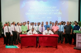 Islamic Minister Dr Ahmed Ziyad (L) and PSM's Managing Director Ibrahim Khaleel sign agreement to create local Islamic TV channel. PHOTO/ISLAMIC MINISTRY